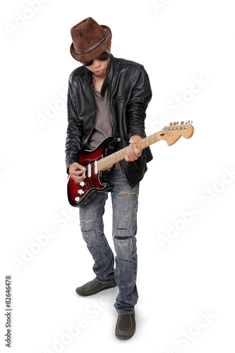 Photo  Blues guitarist playing his cool solo, isolated on white