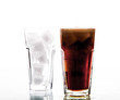 soft drinks. Cola glass with ice cubes over white