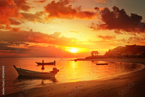 Traditional thai boats at sunset beach Poster