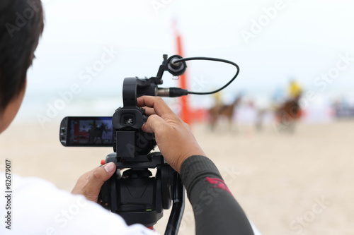 Fotografie, Obraz  Cameraman working on recording on a beach Polo Tournament