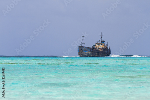 Photo Wreck aground over reef