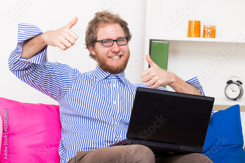 Fotografie, Obraz  Happy man shows OK sign in front of a computer