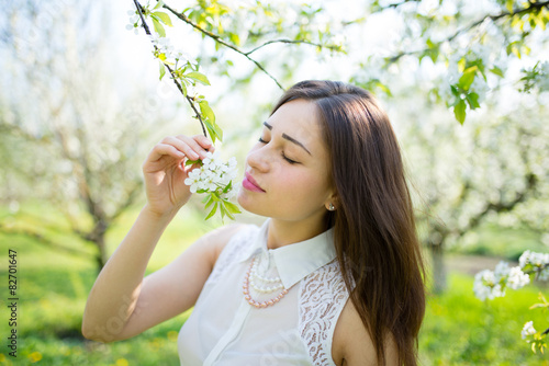 Fotografie, Obraz  beautiful dreamy girl near blossoming branch