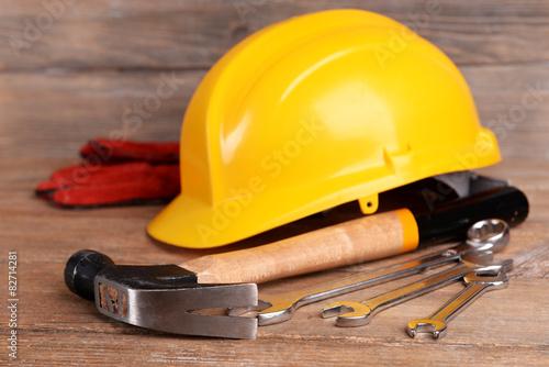 Fototapeta Construction tools with helmet on table close up obraz na płótnie