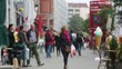 People walking out of focus