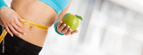 Fotografia  Woman holding an apple
