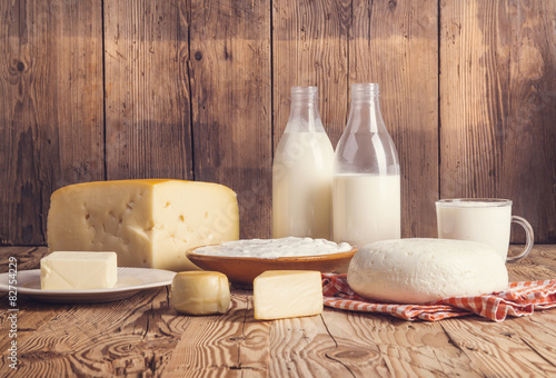 Papiers peints Produit laitier Variety of dairy products laid on a wooden table background