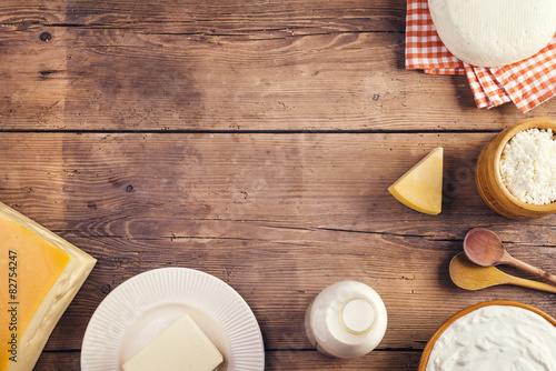 Staande foto Zuivelproducten Variety of dairy products laid on a wooden table background