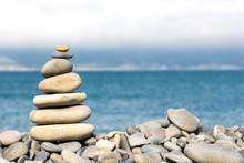 Balanced Stone Pyramide On Sea Shore