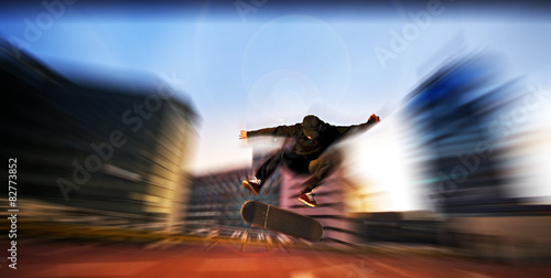 Young man jumping in the air with skate board skateboard