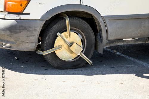 Police anti-theft device on car wheel Canvas Print
