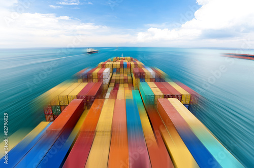 Fotografia  Large container vessel in Singapore ship motion blur