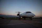 Business jet airplane on the ground. Evening.