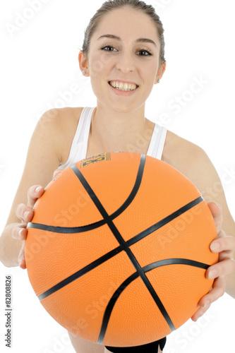 Fotografiet  Frau spielt Basketball
