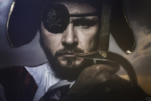 Pirate With Hat And Eye Patch Holding A Sword