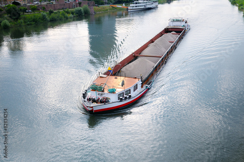 barge with cargo on river Fototapeta
