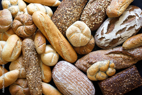 Obraz Many mixed breads and rolls shot from above. - fototapety do salonu