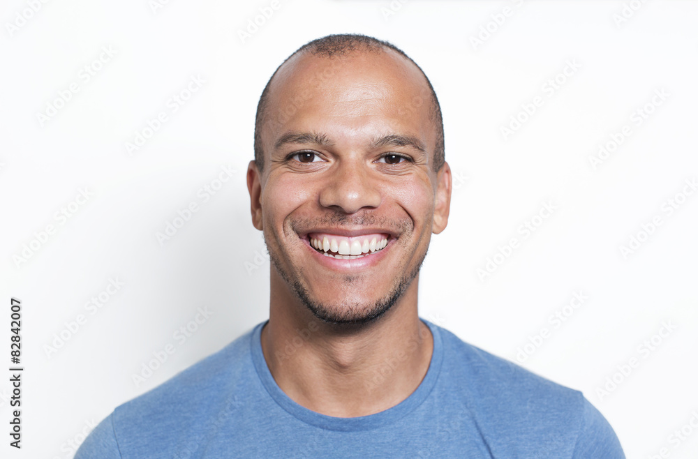 Fototapeta Portrait of a handsome mixed race man smiling to camera