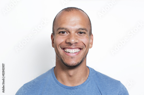 Fototapeta Portrait of a handsome mixed race man smiling to camera obraz