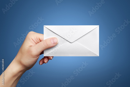 Woman's hand holding closed envelope