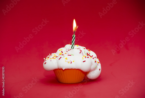 Cupcake with a lit candle Poster