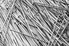 Shiny Iron Nails Close Up Photo