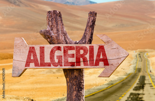 Tuinposter Algerije Algeria wooden sign with desert road background