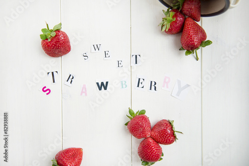 Foto op Canvas In het ijs Sweet Strawberry Letters cut out from the Magazine