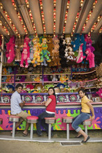 Multi-ethnic Teenaged Friends At Carnival Booth