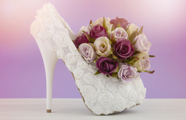 Naklejka Wedding Bridal concept with white floral high heel shoe and rose