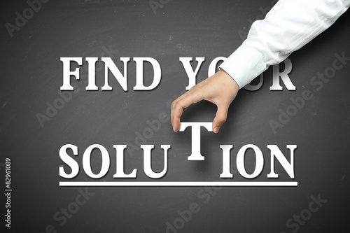 Hand holding find your solution concept Wallpaper Mural