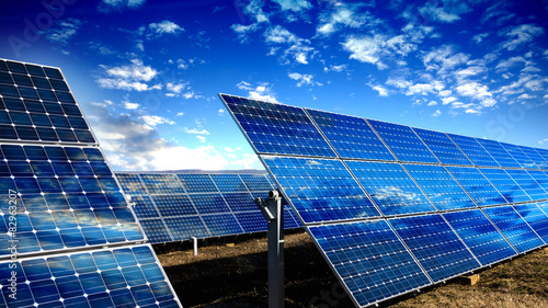 Solar panels modules and blue sky with clouds