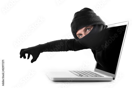 Fotografía  hacker stealing  hand out of computer cyber crime concept