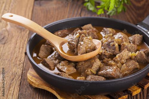 Fotografie, Obraz  Beef stew - wooden background