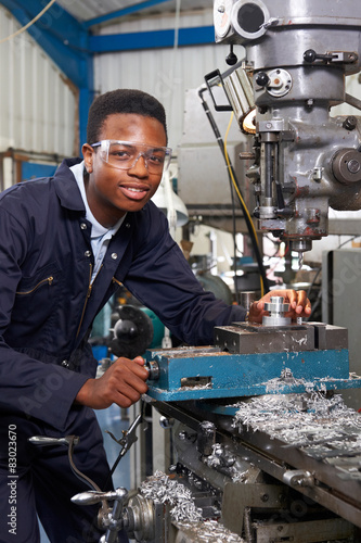 Male Apprentice Engineer Working On Drill In Factory Canvas Print