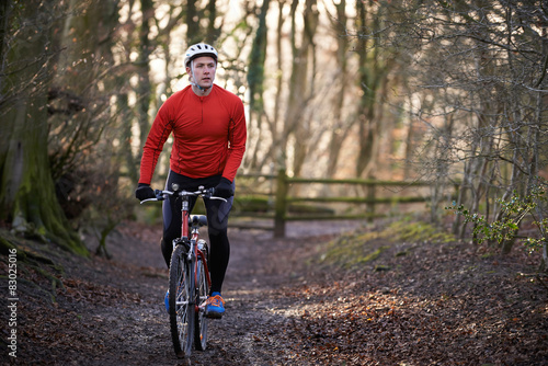 Aluminium Prints Cycling Man Riding Mountain Bike Through Woodlands