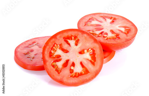 Fotografía  Slice tomato isolated on the white background