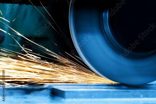 Sparks from grinding machine. Industrial, industry Fototapeta