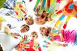 Leinwandbild Motiv smiling kids with colourfull hands