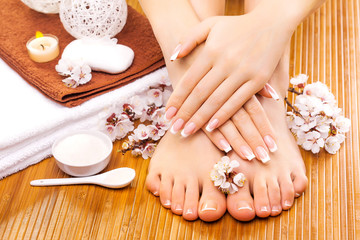 Fototapeta Do Spa brown manicure and pedicure on the bamboo