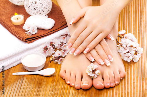 Foto op Canvas Pedicure brown manicure and pedicure on the bamboo