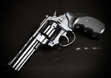 Revolver Gun On Black Background