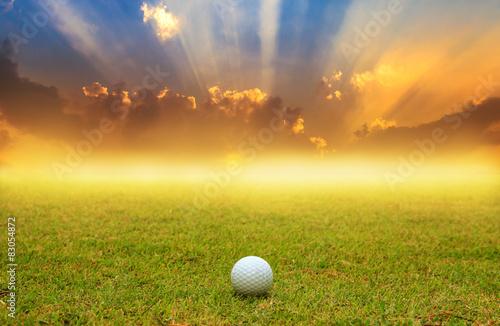 Deurstickers Golf golf ball in fairway on sunrise with fog