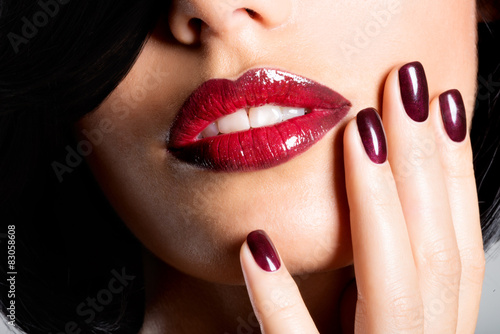 Closeup face of a woman with beautiful sexy red lips and dark na Poster