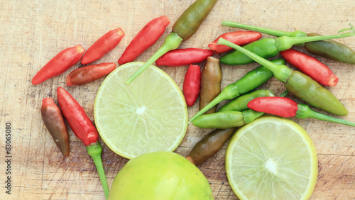 Fototapety, obrazy: Slice lemon and chili on wood background.