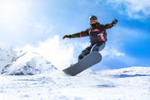 Jumping Snowboarder From Hill ...