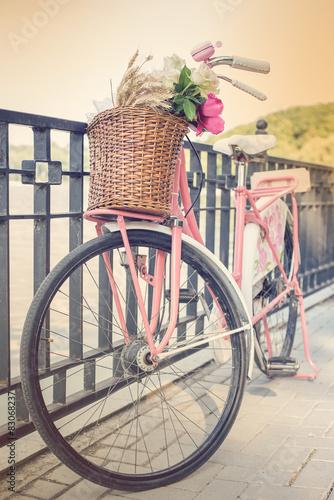 Foto op Plexiglas Retro Vintage pink bicycle with flower basket