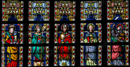 Stained glass window depicting Catholic Saints Canvas Print