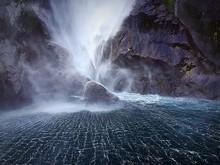 Light Misty Water Falling Over Rocks Into Water