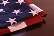 Folded American flag on brown table top
